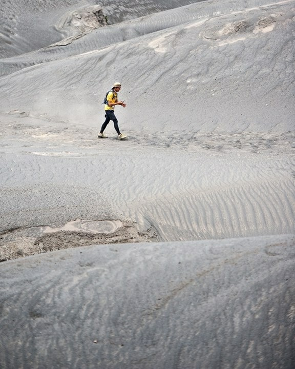 A runner crossing the sand dunes